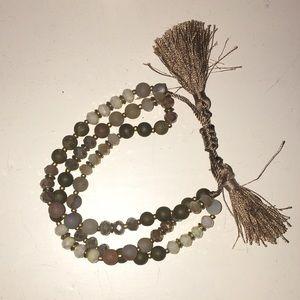 Multistrand glass bracelet with tassels